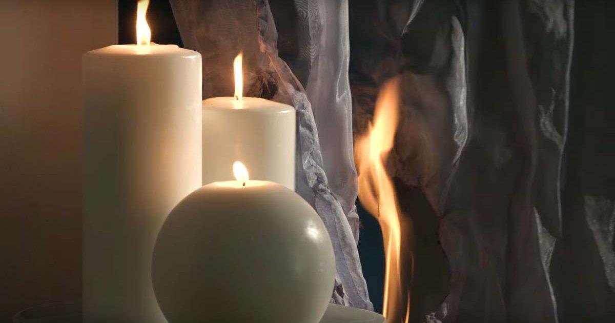 Vorhänge fangen Feuer durch brennende Kerzen